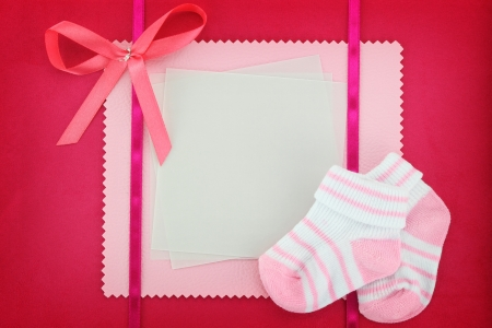 name day: Blank card with baby socks on blue background