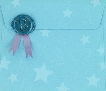 Blue envelope with sealing wax stamp photo