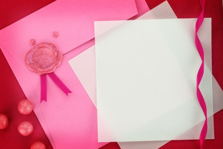 Paper card and pink envelope with sealing wax stamp photo