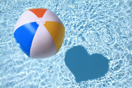 ball on water: Summer love, Beach Ball on the swimming Pool with heart shaped shadow