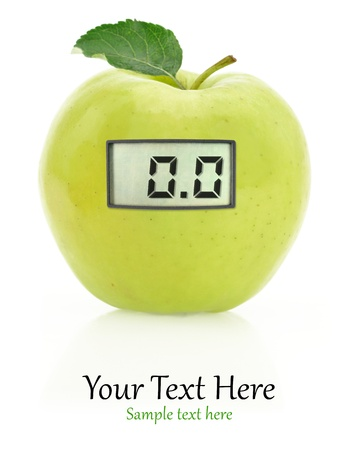 dietitian: Digital weight scale on a green apple Stock Photo