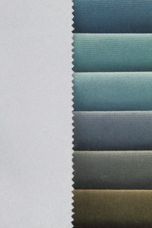 Color background of blue tones fabric samples photo