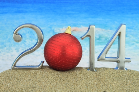 New year 2014 with Christmas ball on the beach  photo