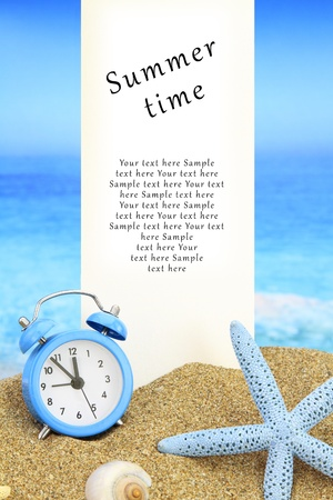 summer time: Summer time. White banner and alarm clock on the beach