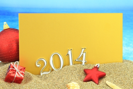 New year 2014 card on the beach photo