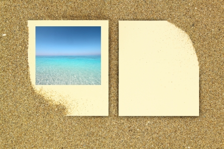 anniversary beach:  frame and paper card on the sand