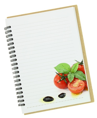 Recipe  book. Fresh basil and cherry tomatoes painting on blank notebook page photo