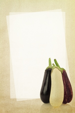 Recipe card. Eggplants on fabric texture photo