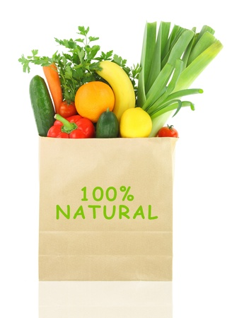 bio: 100 Percent Natural on a grocery bag full of vegetables and fruits