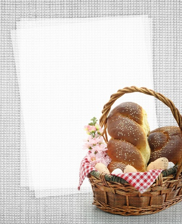 Easter sweet bread in a basket with blank paper recipe card photo