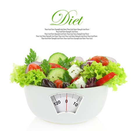 lose: Diet meal. Vegetables salad in a bowl with weight scale
