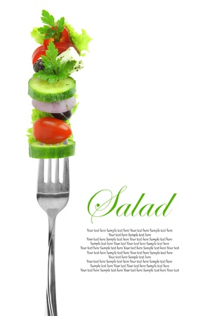 salad fork: Fresh mixed vegetables on fork  Stock Photo