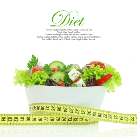 feta: Diet meal. Vegetables salad in a bowl with measuring tape