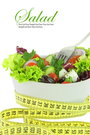 greek chef: Diet meal. Vegetables salad in a bowl with measuring tape