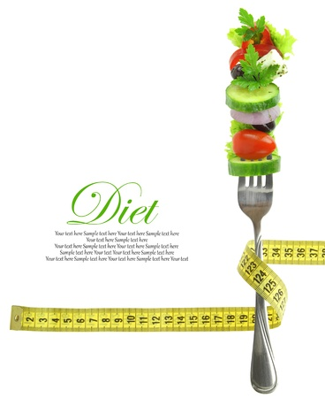 diabetes: Fresh mixed vegetables on fork with measuring tape  Stock Photo