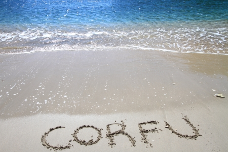"corfu: ""Corfu"" written on sandy beach"