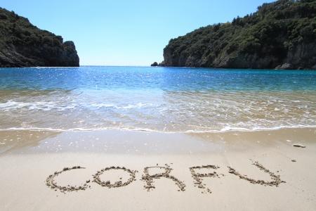 Corfu written on sandy beach
