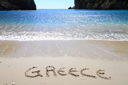 "corfu: Greece"" written on sandy beach Stock Photo"