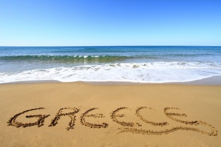 corfu: Greece written on golden sandy beach