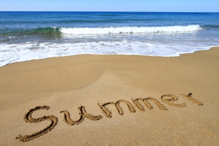 Summer written on golden sandy beach Stock Photo - 18783596