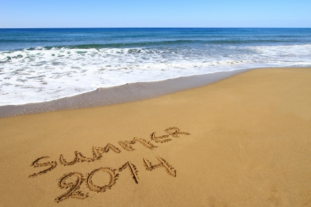 Summer 2014 written on sandy beach photo