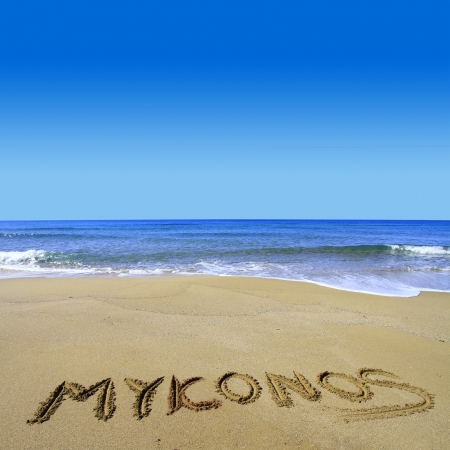 Mykonos written on sandy beach Stock Photo - 18931595