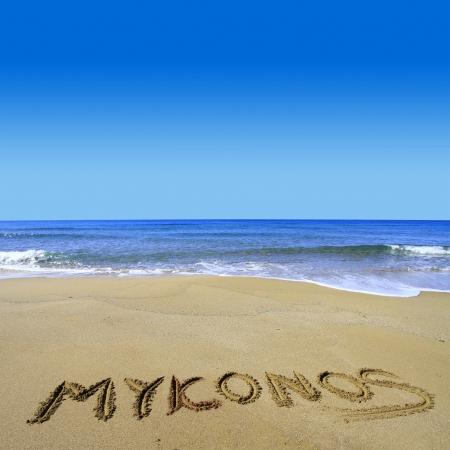 kyklades: Mykonos written on sandy beach Stock Photo