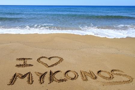 kyklades: I Love Mykonos written on sandy beach Stock Photo