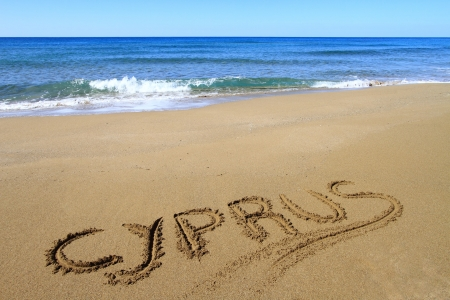 sands of time: Cyprus written on sandy beach Stock Photo