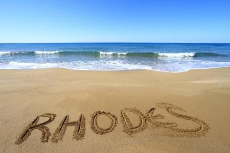 Rhodes written on sandy beach Stock Photo - 18931596
