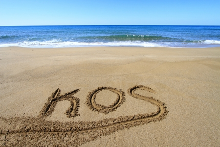 Kos written on sandy beach Stock Photo - 18931611