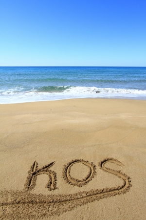 kos: Kos written on sandy beach