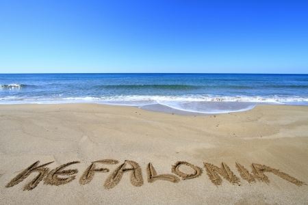 kefalonia: Kefalonia written on sandy beach