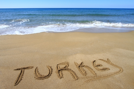 Turkey written on sandy beach Stock Photo - 18931608