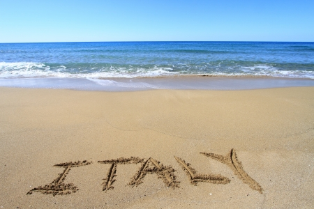 sand writing: Italy written on sandy beach