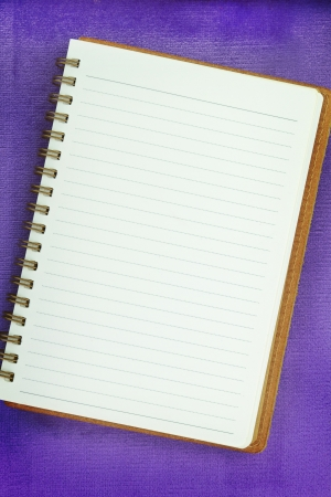 mov: White Blank notebook on purple background Stock Photo