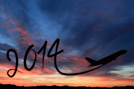 january sunrise: New year 2014 drawing by airplane on the air at sunset