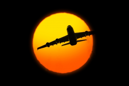 Beautiful sunset with airplane on black background Stock Photo - 18987803