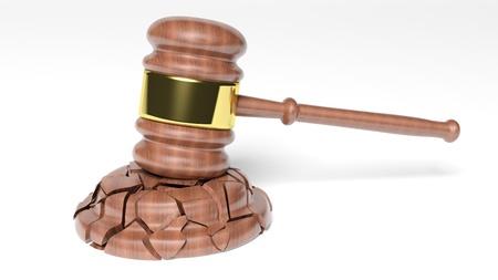 Broken Judges Gavel over white background photo