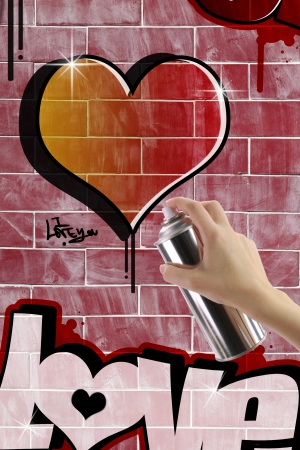 Heart graffiti on red brick wall photo
