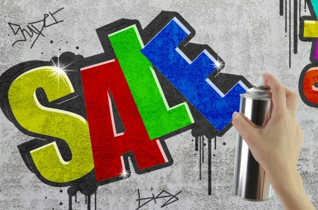 Sale graffiti on concrete wall photo