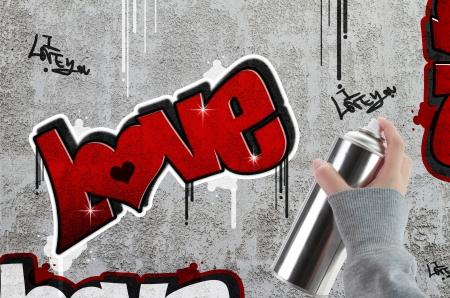 Love graffiti on concrete wall photo