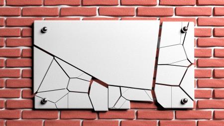 Broken frame on brick wall photo