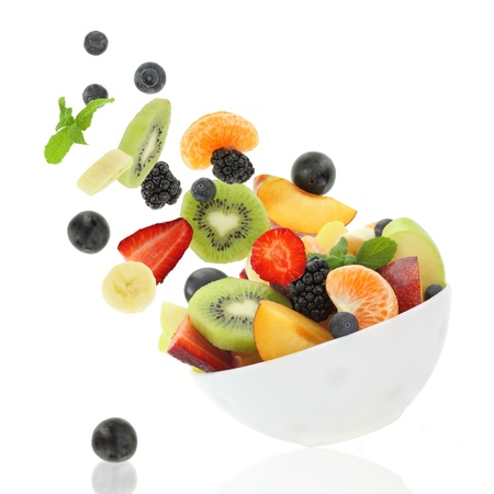 fruit salad: Fresh fruits coming out from a bowl