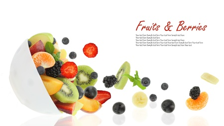 mixed fruit: Fresh fruits coming out from a bowl