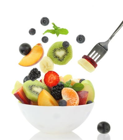 Fresh fruits coming out from a bowl Stock Photo - 19358388