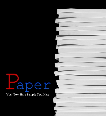 Close up of stack of papers on black background photo