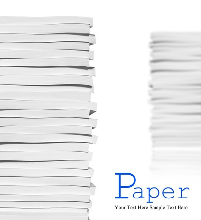 magazine stack: Close up of stack of papers on white background