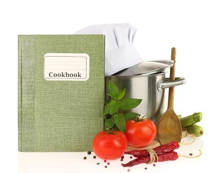 steel pan: Libro de cocina, las verduras y cacerolas aisladas en blanco Foto de archivo