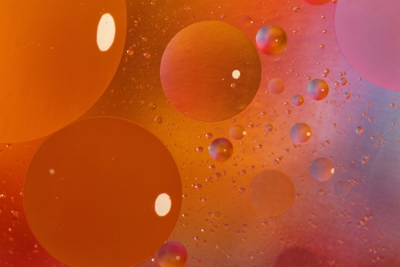 Abstract orange background with bubbles in the water photo